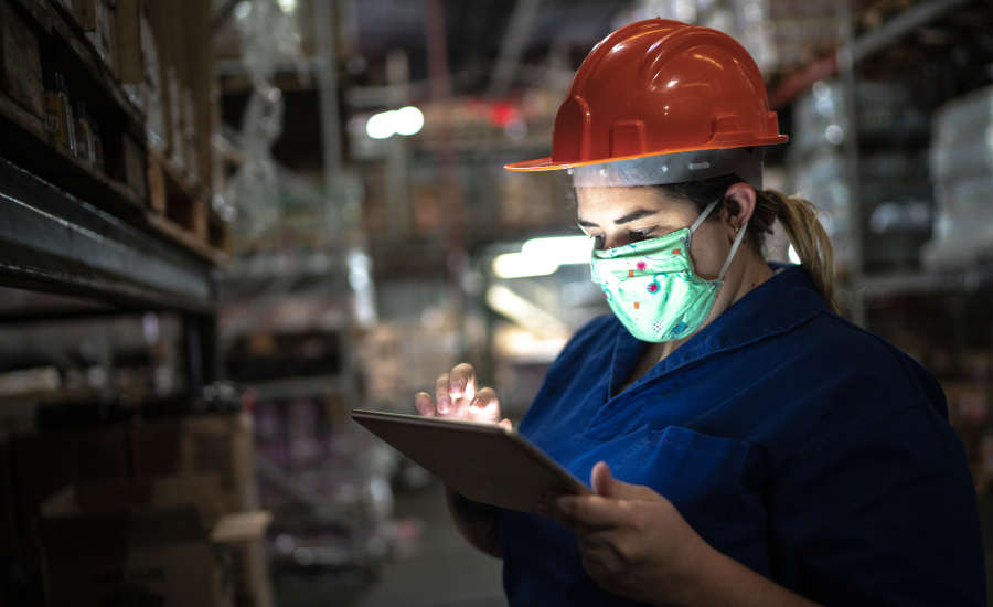 Woman in hard hat with tablet