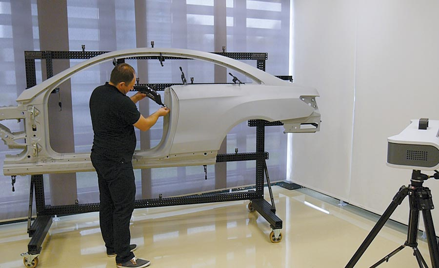 The operator conducts the pre-alignment of the side panel.