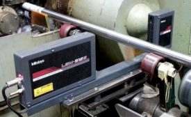 Laser scan micrometer measuring diameter immediately after finish grind operation.