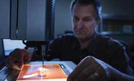 Dan Bukaty Jr. at the Starrett AV300 measuring a part.