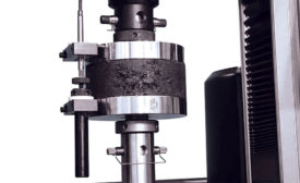 Compression testing on a cylindrical specimen.
