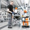 man and manufacturing robot
