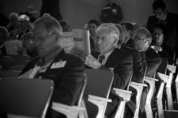 men speaking at conference