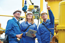 three workers in hard hat inspecting audit quality