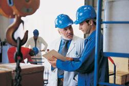 management men working factory floor