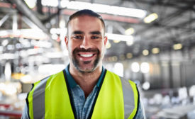 Man in reflective vest in factory setting