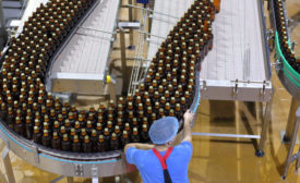 man in bottling plant