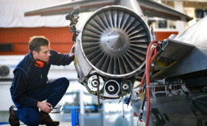 Man inspecting jet engine
