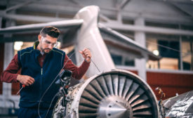 man and airplane engine