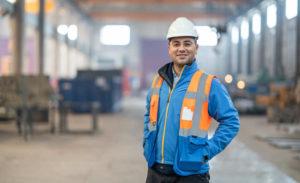Man in hard hat in factory