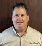 Head shot: William (B.J.) Hangartner,  president of Quality Calibration Service Inc